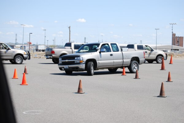WDFW Officers driving the autocross skills course