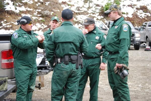 Officers discussing tactics at a firearm qualification